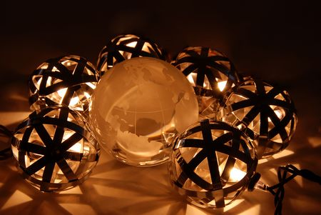 navigational light: Ball lanterns of metal strips forming geometric shapes in light surrounding a crystal globe