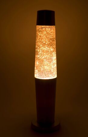 Sparkling abstract glitter floating in the abyss of a lava lamp