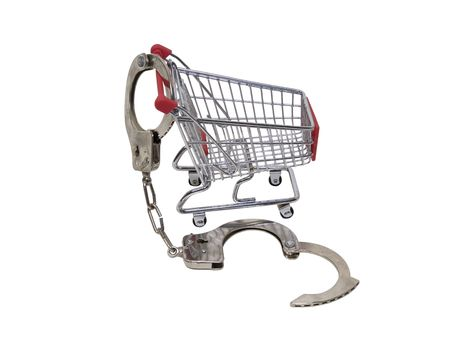 Handcuffs made of metal with mechanical clasp attached to a cart to show locked into shopping Stock Photo