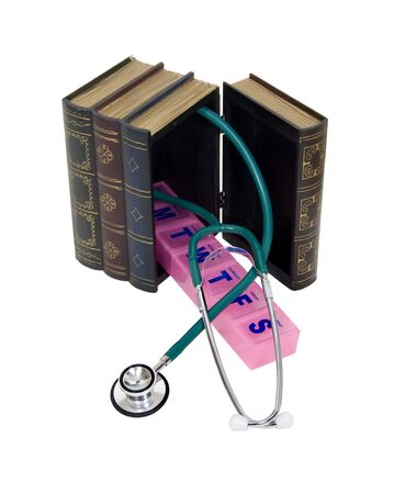 resemble: Large wooden block hollowed and carved to resemble a book full of medical equipment such as a stethoscope and pill container