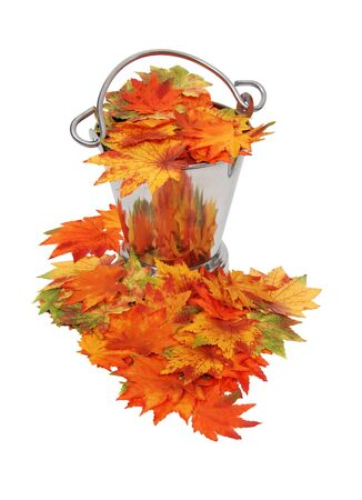 Bright and colorful fall leaves filling an ice bucket with a handle