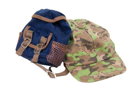 A camouflage baseball hat for everyday wear when you want to blend in with the crowd and a backpack for carrying essentials Reklamní fotografie - 5113257