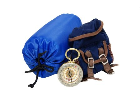 sleeping bag: Backpack with rolled up sleeping bag and compass for overnight trips