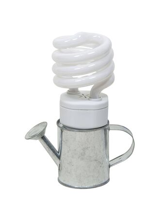 Growing green concepts to help preserve our natural resources showing by spiral lightbulb and watering tin