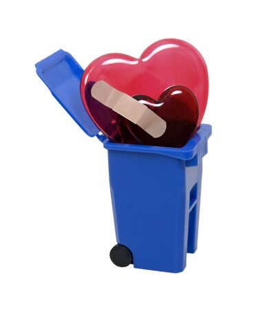 bandaged: Recycle bin used to hold items to be reduced and reused filled with bandaged broken hearts