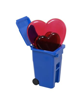 Red and pink glass hearts symbolizing love and romance in a recycling bin Stok Fotoğraf