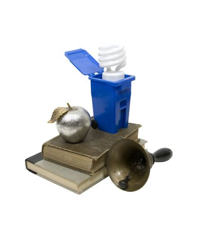 A variety of antique teaching and school items with a recycling bin and spiral lightbulb Stock Photo - 5133019