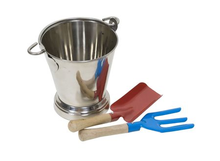 tending: Tools and pail used for tending the garden to make plants grow  Stock Photo