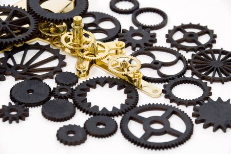 Various black and gold gears with interlinking teeth and cogs