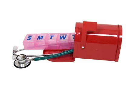Red metal mailbox with signal flag with a stethoscope and a daily medicine minder - included Stock Photo - 5222326