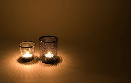 candle: Fancy patterned candle holders that splash diamonds around with light