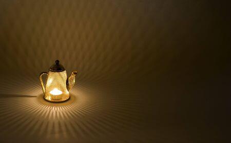 candle holder: Mesh tea pot decoration candle holder splashing diamond shapes along the floor  Stock Photo
