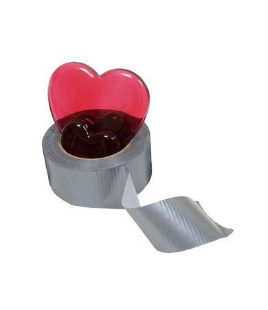 Heartbreak repair kit containing silver lined duct tape for everyday household use and red glass hearts - included Stock Photo - 5258120