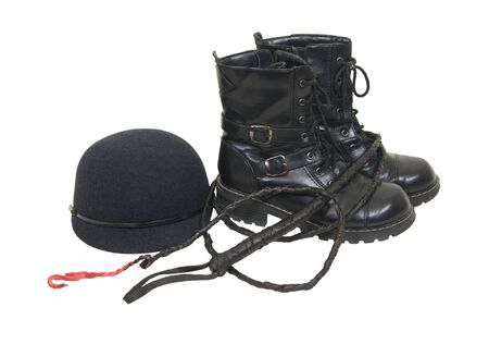 Retro felt riding cap for informal equestrian events with black boots and whip - included Stock Photo - 5258523