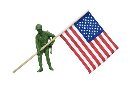 plastic soldier: Soldier as represented by a green plastic model carrying an American flag
