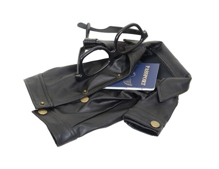 Spy kit consisting of a black leather overcoat, passport and dark glasses - included Stock Photo - 5258526