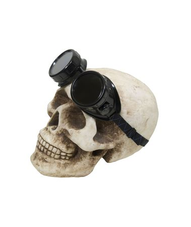 Black goggles used for eye protection and fashion statement on a skull