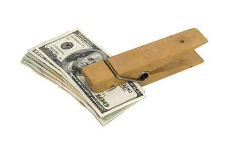 clamped: Paperclip used to hold pages or other media together clamped on a stack of money