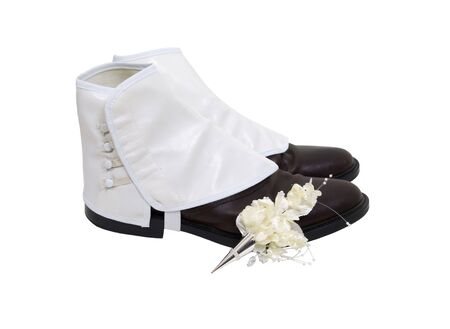 Silver boutanniere holder with a floral decoration for formal affairs on a pair of shoes with spats Stock Photo - 5397894