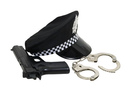 Policeman kit including a black Police hat with badge and a shiny brim, and a gun with a set of handcuffs