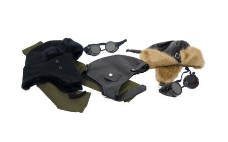 Several Black leather and fur aviator hats with goggles and a scarf Stock Photo - 5397687