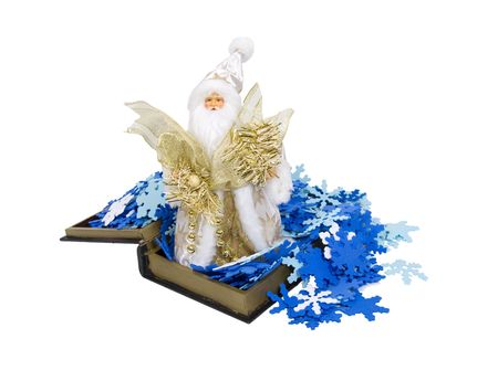 Father Winter in a white robe with golden stars holding ribbons and beads on a bed of snowflakes in an open book photo