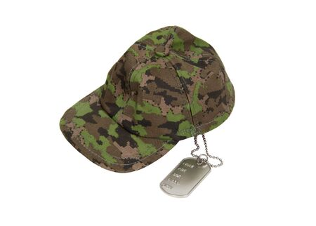 Military style hat and dog tags used as an identifier in lieu of cards photo