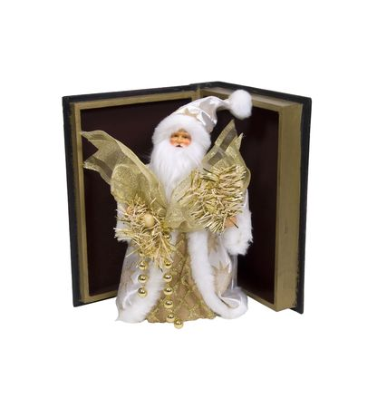 Santa claus in a white robe with golden stars holding ribbons and beads in an open book for winter stories photo
