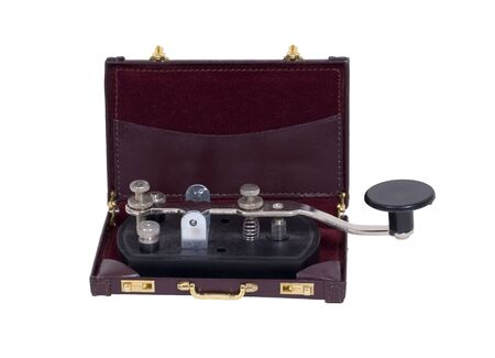 telegraphy: Business communication shown by an antique telegraph key in a briefcase - path included