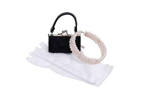 luxuries: Luxuries of a pearl necklace, white gloves and black purse