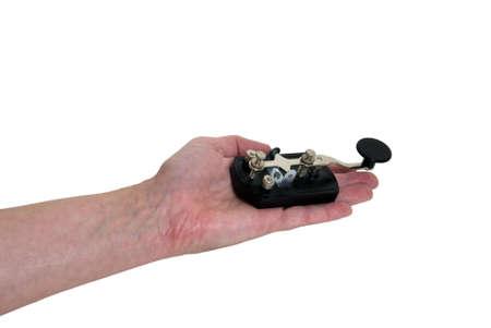 telegraphy: Offerta comunicazione dimostrata dal possesso di una chiave di telegrafo antico usata come un dispositivo di comunicazione per il codice Morse Archivio Fotografico