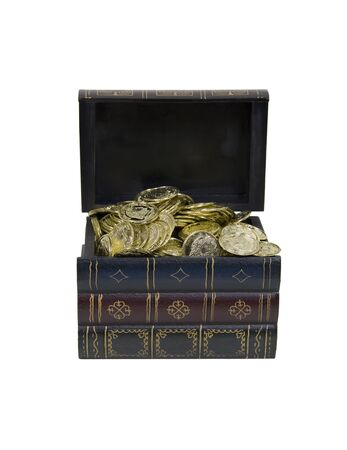 booty pirate: Treasure within shown by a large book filled with golden coins Stock Photo