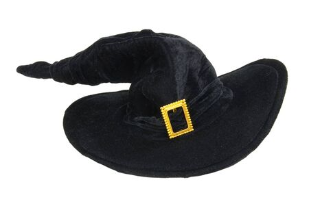 Traditional large pointed black witch hat with a brass buckle Imagens