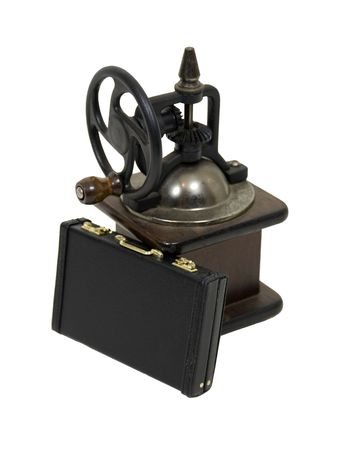 daily grind: The daily grind shown by a briefcase leaning against an antique manual grinder