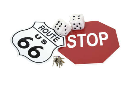 Road trip shown by road signs, fuzzy dice and a set of keys photo