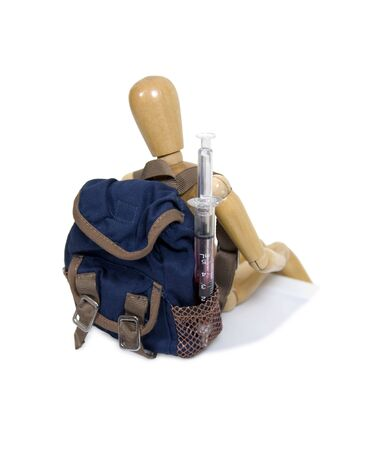 Healthcare on the go shown by a medical syringe tucked into a backpack