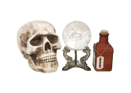 foresee: Poison potion shown by bottle with razor, crystal ball and skull  Stock Photo