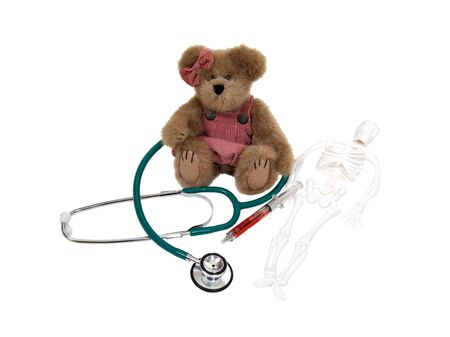 Pediatric medical care shown by medical items with a teddy bear - path included