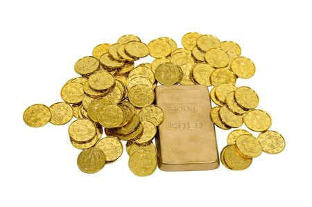 Large gold bar with many gold coins showing success, wealth and luxury
