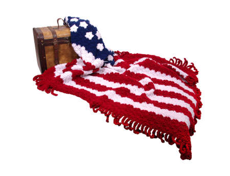 Flag afgan made by crocheting yarn in a pattern and a antique wooden trunk Stock Photo - 5945613