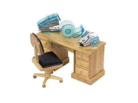 office stapler: Attention in the details shown by oversized office tools including stapler, stapler puller, and tape dispenser on a wooden desk