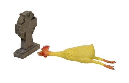 Rubber chicken is a long standing gag prop for pranksters shown with a tombstone to show it is a dead joke