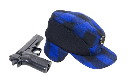 warmth: Blue and black plaid hunters cap with ear flaps for warmth with a gun - path included