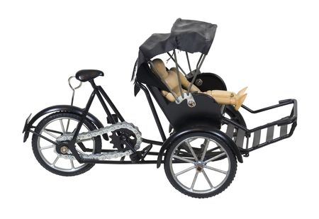 sitesee: Energy efficient by riding in a bicycle and black carriage rickshaw - path included Stock Photo