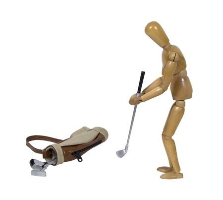 Teeing off with a golf club with a golf bag laying nearby - path included 版權商用圖片 - 5986265