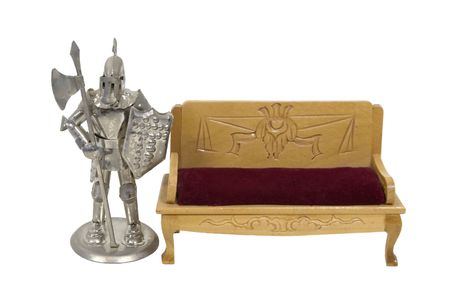 Medieval knight wearing armor for protection and display of power next to a formal bench