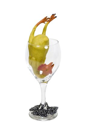 glasswear: Serving of fun shown by a rubber chicken in a wine glass