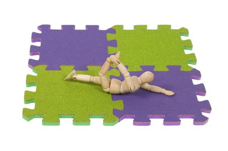 tumbling: Stretching for gymnatics and tumbling on the mat is a graceful array of movement - path included Stock Photo