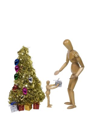 Handing out presents from under a brightly decorated golden Christmas tree - path included photo
