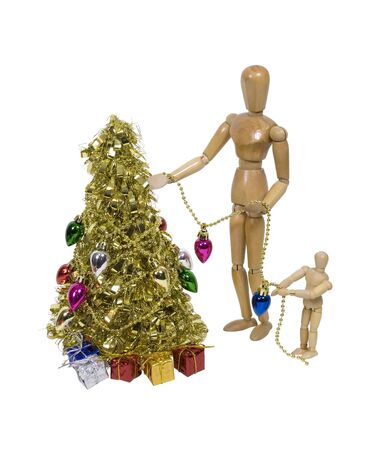 Decorating a brightly decorated golden Christmas tree for celebrating the winter season - path included Stock Photo - 6039072